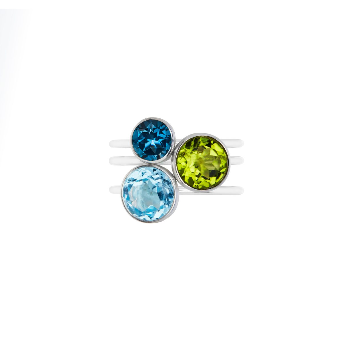 Small London Blue Topaz stacking ring in silver. Large Peridot and silver stacking ring, large Sky Blue Topaz and silver stacking ring.