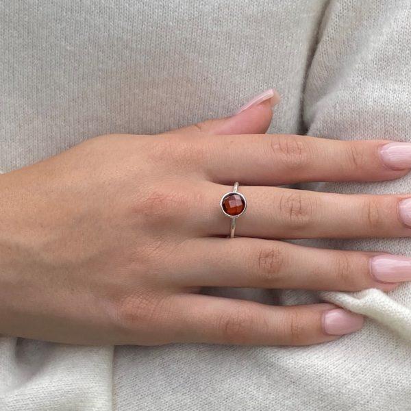 Shakara Jewellery Bonbon collection. Round Garnet gemstone stacking ring.